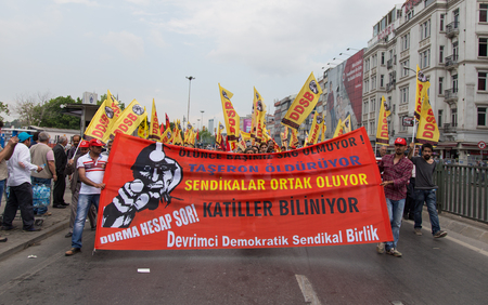 subcontractors: ISTANBUL, TURKEY - MAY 25, 2014: Unions march in protest against subcontractors in Turkey. Subcontractors killing write on banner Editorial