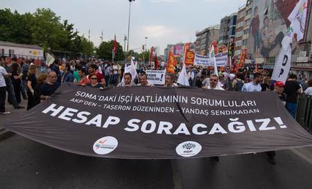subcontractors: ISTANBUL, TURKEY - MAY 25, 2014: Unions march in protest against subcontractors in Turkey. We will account for responsible for the massacre of the soma mine disaster write on banner