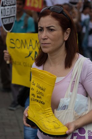 subcontractors: ISTANBUL, TURKEY - MAY 25, 2014: Unions march in protest against subcontractors in Turkey. Most clean thing is your boot write on boat