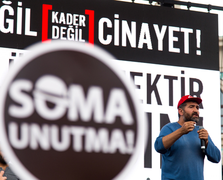 ISTANBUL, TURKEY - MAY 25, 2014: A Soma mine miner speaks in protest against subcontractors in Turkey. Dont forget Soma write on banner