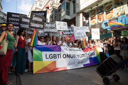 ISTANBUL, TURKEY - JUNE 29, 2014: 22. LGBTI Pride March held in Istiklal Avenue, Istanbul. Tens of thousands of people gathered to celebrate LGBT Honor week.