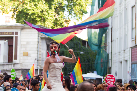 ISTANBUL, TURKEY - JUNE 29, 2014: Man in 22. LGBTI Pride March held in Istiklal Avenue, Istanbul. Tens of thousands of people gathered to celebrate LGBT Honor week.