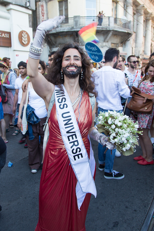 ISTANBUL, TURKEY - JUNE 29, 2014: Woman in 22. LGBTI Pride March held in Istiklal Avenue, Istanbul. Tens of thousands of people gathered to celebrate LGBT Honor week.