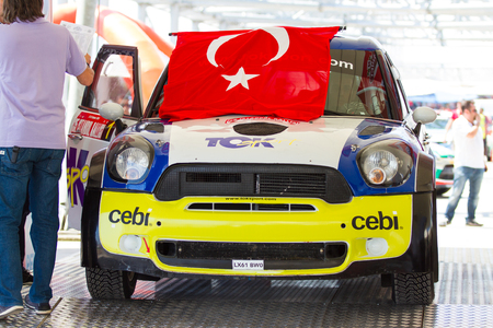 ISTANBUL, TURKEY - JULY 12, 2014: Yagiz Avci with Mini Cooper JWRC of Toksport WRT Team in start podium of 35. Istanbul Rally Editöryel