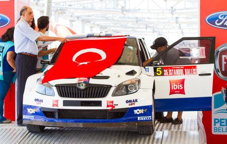 ralli: ISTANBUL, TURKEY - JULY 12, 2014: Burak Cukurova with Skoda Fabia of Toksport WRT Team in start podium of 35. Istanbul Rally