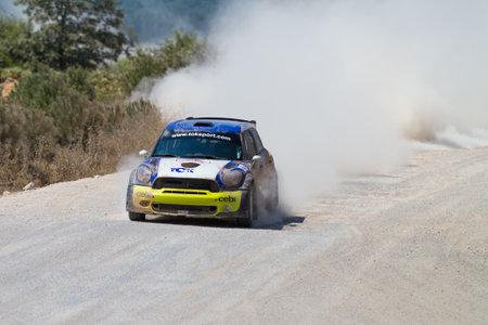 ralli: ISTANBUL, TURKEY - JULY 13, 2014: Yagiz Avci drives Mini Cooper JWRC of Toksport WRT Team in 35. Istanbul Rally, Ulupelit ITO Stage