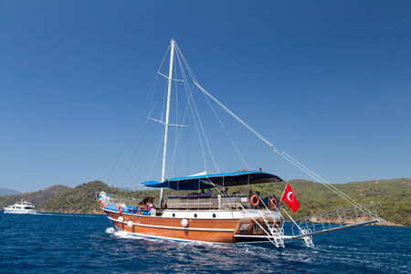 GOCEK, MUGLA, TURKEY - JULY 15, 2014: People in sailboat tour in Aegean sea. Aegean tours are one of the most populer activity for tourists in southern Turkey.