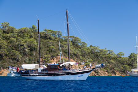 mugla: GOCEK, MUGLA, TURKEY - JULY 16, 2014: People in sailboat tours in Aegean sea. Aegean tours are one of the most populer activity for tourists in southern Turkey. Editorial