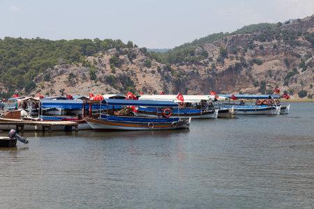 morass: DALYAN, MUGLA, TURKEY - JULY 18, 2014: Boats in Dalyan river tour. River tour between Koycegiz lake and Iztuzu beach is one of the most populer activity in Dalyan. Editorial