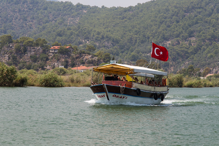 mugla: DALYAN, MUGLA, TURKEY - JULY 18, 2014: People in Dalyan river tour. River tour between Koycegiz lake and Iztuzu beach is one of the most populer activity in Dalyan.