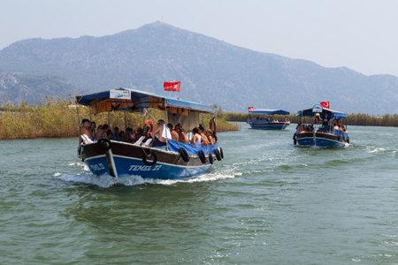 morass: DALYAN, MUGLA, TURKEY - JULY 18, 2014: People in Dalyan river tour. River tour between Koycegiz lake and Iztuzu beach is one of the most populer activity in Dalyan.