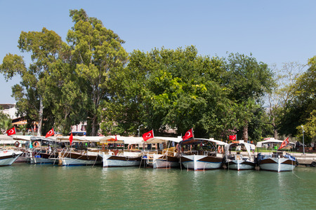 mugla: DALYAN, MUGLA, TURKEY - JULY 18, 2014: Tour boats in Dalyan river. River tour between Koycegiz lake and Iztuzu beach is one of the most populer activity in Dalyan.