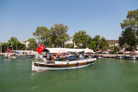 mugla: DALYAN, MUGLA, TURKEY - JULY 18, 2014: Tour boats in Dalyan river. River tour between Koycegiz lake and Iztuzu beach is one of the most populer activity in Dalyan.