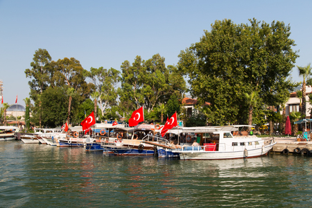 morass: DALYAN, MUGLA, TURKEY - JULY 18, 2014: Tour boats in Dalyan river. River tour between Koycegiz lake and Iztuzu beach is one of the most populer activity in Dalyan.