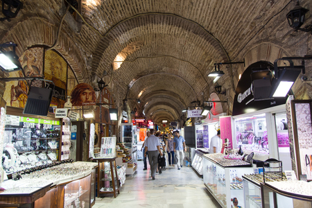IZMIR, TURKEY - JULY 21, 2014: People shopping in old Kizlaragasi Bazaar where was built in 1744 and one of the most popular traditional Bazaar in Izmir.