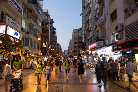 kibris: IZMIR, TURKEY - JULY 21, 2014: People in Kibris Sehitleri Avenue where is one of the most popular destination for shopping and entertainment in Izmir.