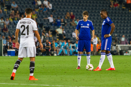 ISTANBUL - AUGUST 08, 2014: Chelsea is using the free kick to Besiktas in Soma Charity Tournament in Sukru Saracoglu Stadium.