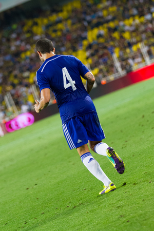 cesc: ISTANBUL - AUGUST 08, 2014: Cesc Fabregas in Besiktas vs Chelsea in Soma Charity Tournament in Sukru Saracoglu Stadium. Editorial