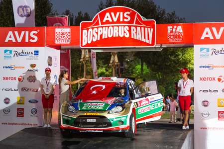 fatih: ISTANBUL, TURKEY - AUGUST 15, 2014: Fatih Kara with Fiat Abarth Punto S2000 car of Pegasus Racing Team in ceremonial start of Avis Bosphorus Rally Editorial