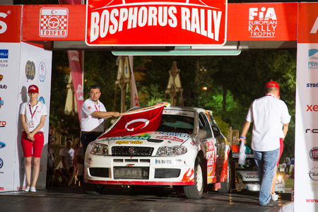 ralli: ISTANBUL, TURKEY - AUGUST 15, 2014: Murat Soycopur with Fiat Punto S1500 car of Pegasus Racing Team in ceremonial start of Avis Bosphorus Rally