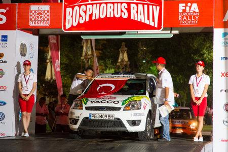ralli: ISTANBUL, TURKEY - AUGUST 15, 2014: Georgi Geradzhiev with Ford Fiesta ST car of ASR Bulgartabac Team in ceremonial start of Avis Bosphorus Rally Editorial