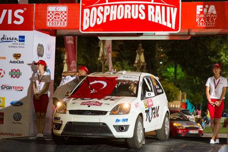 ralli: ISTANBUL, TURKEY - AUGUST 15, 2014: Kerim Tar with Ford Fiesta ST car in ceremonial start of Avis Bosphorus Rally