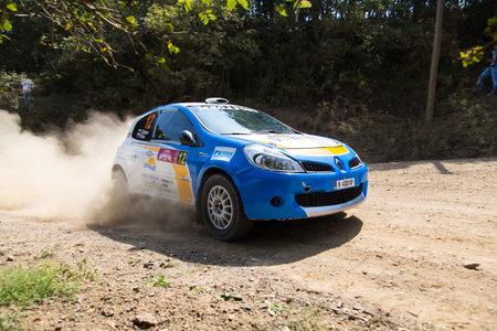 bulbet: ISTANBUL, TURKEY - AUGUST 16, 2014: Todor Slavov drives Renault Clio R3 car of Bulbet Rally Team in Avis Bosphorus Rally, Deniz Stage