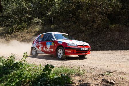 ISTANBUL, TURKEY - AUGUST 16, 2014: Mehmet Vehbi Usluoglu drives Peugeot 106 GTI car in Avis Bosphorus Rally, Deniz Stage Editorial