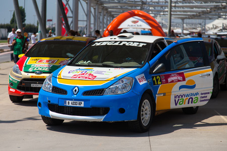 bulbet: ISTANBUL, TURKEY - AUGUST 16, 2014: Todor Slavov with Renault Clio R3 car of Bulbet Rally Team in Avis Bosphorus Rally park area