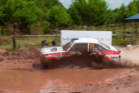 kap: ISTANBUL, TURKEY - AUGUST 17, 2014: Engin Kap drives Ford Escort MKII car of Bonus Unifree Parkur Racing Team in Avis Bosphorus Rally, Gocbeyli Stage