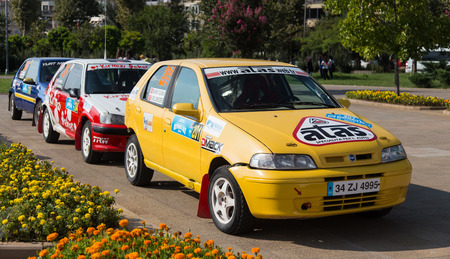 ralli: ISTANBUL, TURKEY - AUGUST 17, 2014: Murat Guray with Fiat Palio car in Avis Bosphorus Rally park area