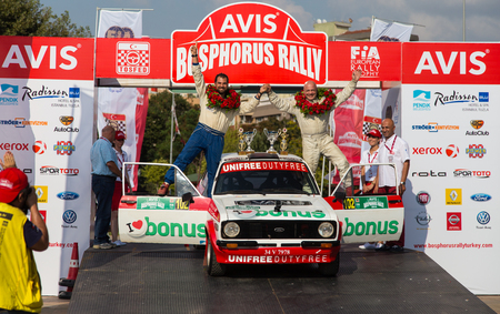 kap: ISTANBUL, TURKEY - AUGUST 17, 2014: Engin Kap with Ford Escort MKII car of Bonus Unifree Parkur Racing Team in Podium Ceremony of Avis Bosphorus Rally