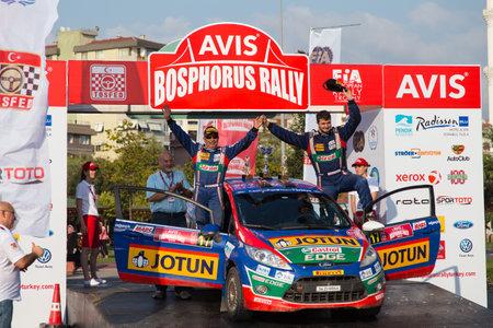 turkiye: ISTANBUL, TURKEY - AUGUST 17, 2014: Umit Can with Ford Fiesta R2 car of Castrol Ford Team Turkiye in Podium Ceremony of Avis Bosphorus Rally