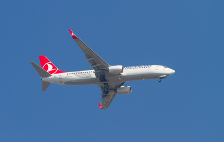 tk: ISTANBUL, TURKEY - AUGUST 16, 2014: Turkish Airlines Boeing 737-800 landing to Sabiha Gokcen Airport. THY is the national flag carrier airline of Turkey with 264 fleet size. Editorial