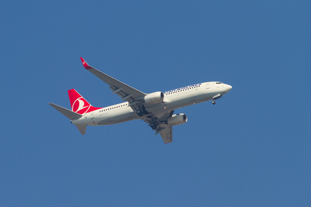 thy: ISTANBUL, TURKEY - AUGUST 16, 2014: Turkish Airlines Boeing 737-800 landing to Sabiha Gokcen Airport. THY is the national flag carrier airline of Turkey with 264 fleet size. Editorial