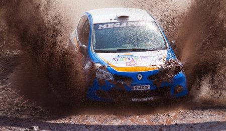 bulbet: ISTANBUL, TURKEY - AUGUST 17, 2014: Todor Slavov drives Renault Clio R3 car of Bulbet Rally Team in Avis Bosphorus Rally, Gocbeyli Stage