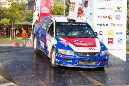 ralli: ISTANBUL, TURKEY - AUGUST 17, 2014: Ugur Soylu with Mitsubishi Lancer Evo IX car of Tok Sport WRT in Podium Ceremony of Avis Bosphorus Rally