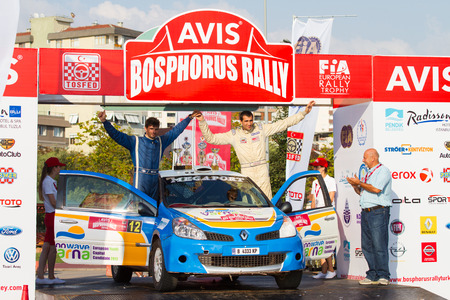 bulbet: ISTANBUL, TURKEY - AUGUST 17, 2014: Todor Slavov with Renault Clio R3 car of Bulbet Rally Team in Podium Ceremony of Avis Bosphorus Rally Editorial