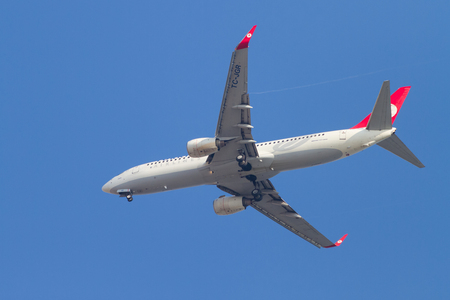 thy: ISTANBUL, TURKEY - AUGUST 17, 2014: Turkish Airlines Boeing 737-800 landing to Sabiha Gokcen Airport. THY is the national flag carrier airline of Turkey with 264 fleet size.