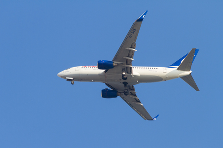 saz: ISTANBUL, TURKEY - AUGUST 17, 2014: Anadolu Jet Airlines Boeing 737-700 landing to Sabiha Gokcen Airport. AnadoluJet is low-cost branch of Turkish Airlines with 28 fleet size. Editorial