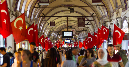 ISTANBUL, TURKEY - AUGUST 30, 2014: People shopping in the Grand Bazaar. The Grand Bazaar is one of the largest and oldest covered markets in the world.