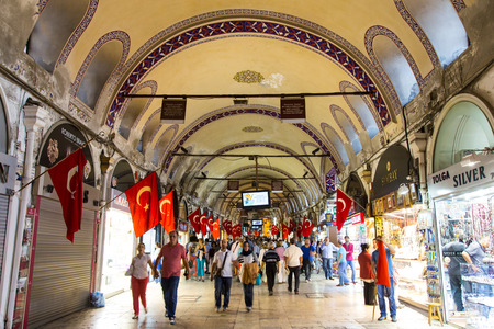 kapalicarsi: ISTANBUL, TURKEY - AUGUST 30, 2014: People shopping in the Grand Bazaar. The Grand Bazaar is one of the largest and oldest covered markets in the world.