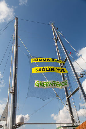 greenpeace: ISTANBUL, TURKEY - SEPTEMBER 7, 2014: Greenpeace Rainbow Warrior ship opened to public in Pasalimani Port. If there are coal there is no health writes on ship. Editorial