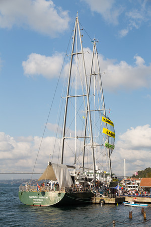 greenpeace: ISTANBUL, TURKEY - SEPTEMBER 7, 2014: Greenpeace Rainbow Warrior ship opened to public in Pasalimani Port. Aim to draw attention to the threat of coal-fired power plants.