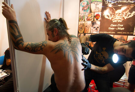 kadikoy: ISTANBUL, TURKEY - SEPTEMBER 20, 2014: Tattoo artist works in Istanbul Tattoo Convention which held in Kadikoy. Editorial
