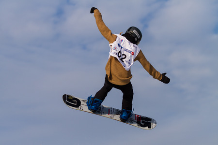 ISTANBUL, TURKEY - DECEMBER 20, 2014: Valentina Barengo jump in FIS Snowboard World Cup Big Air. This is first Big Air event for both, men and women.