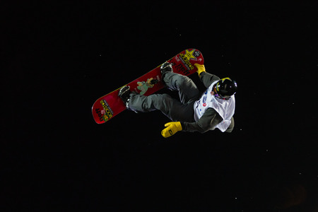 fis: ISTANBUL, TURKEY - DECEMBER 20, 2014: Brandon Davis jump in FIS Snowboard World Cup Big Air. This is first Big Air event for both, men and women.