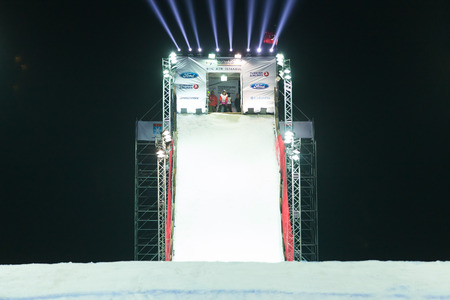 ISTANBUL, TURKEY - DECEMBER 20, 2014: Sina Candrian jump in FIS Snowboard World Cup Big Air. This is first Big Air event for both, men and women.