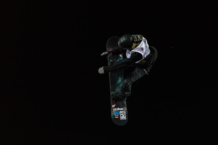 fis: ISTANBUL, TURKEY - DECEMBER 20, 2014: Urska Pribosic jump in FIS Snowboard World Cup Big Air. This is first Big Air event for both, men and women.
