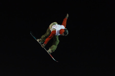fis: ISTANBUL, TURKEY - DECEMBER 20, 2014: Ryan Stassel jump in FIS Snowboard World Cup Big Air. This is first Big Air event for both, men and women.